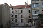 The damaged building that was raided earlier in the morning is pictured on November 18 2015 in SaintDenis France French Police special forces raided...