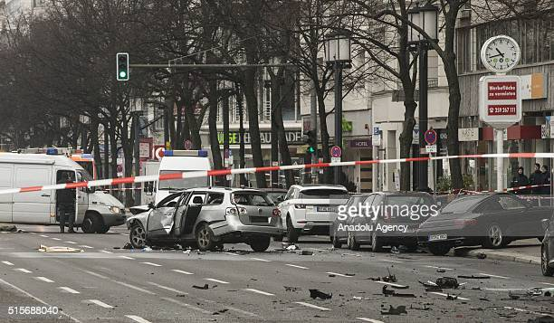 The damaged car and its pieces are seen on a road at Bismarck Street in the Charlottenburg neighborhood after it exploded in Berlin Germany on March...