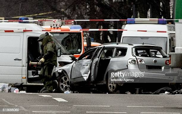 The damaged car is seen on a road at Bismarck Street in the Charlottenburg neighborhood after it exploded in Berlin Germany on March 15 2016 A man...