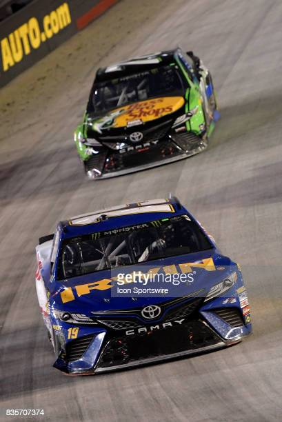 The damaged Daniel Suarez Joe Gibbs Racing Toyota Camry is chased by Martin Truex Jr Furniture Row Racing Toyota Camry during the Bass Pro Shops NRA...