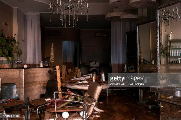TOPSHOT The damaged furniture of a hair salon is covered with mud in Mandra northwest of Athens on November 15 after heavy overnight rainfall At...