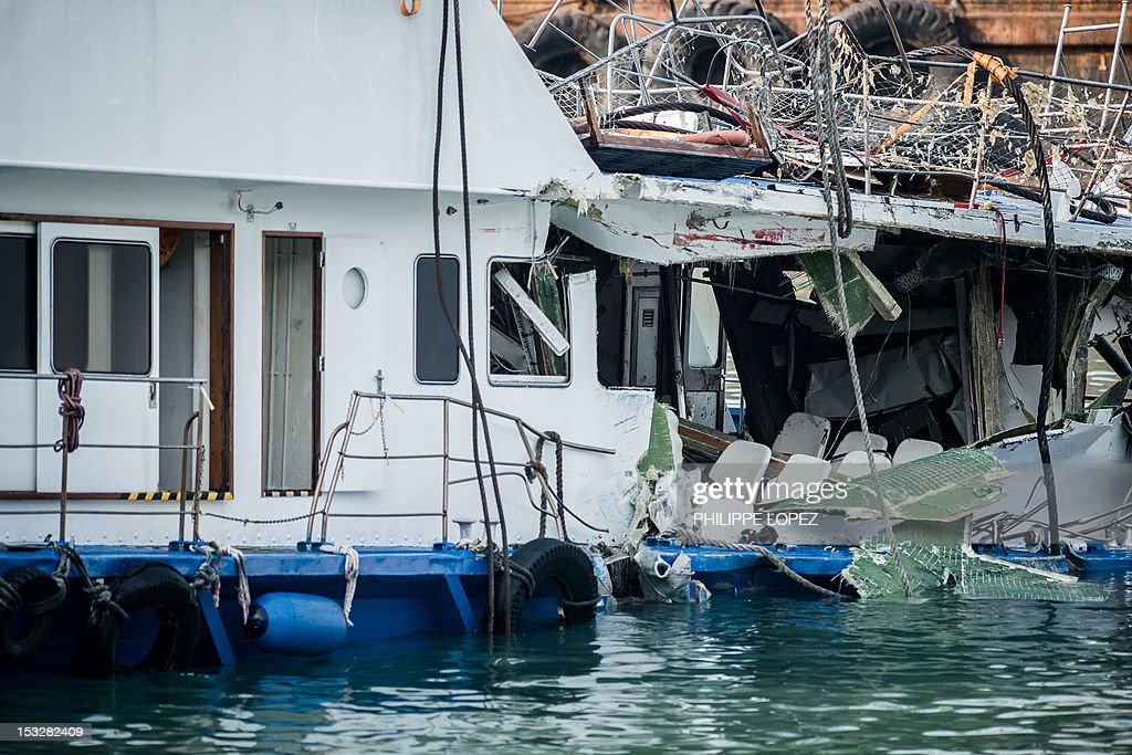 The damaged Lamma IV passenger boat with the back end of the vessel badly damaged after a collision is pictured near the shores of Hong Kong's Lamma...
