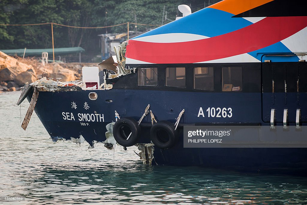 The damaged Sea Smooth ferry is seen docked at Lamma island in Hong Kong on October 3 2012 two days after it collided with a pleasure boat killing at...