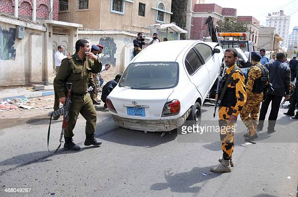 The damaged vehicle of Colonel Mohammed Fadhel Hussein is removed by a tow truck after an explosive device planted under the driver's seat went off...