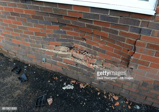 The damaged wall at The Alliance pub in Moston where a man crashed his car after an incident at a house on Delta Walk in Moston Manchester