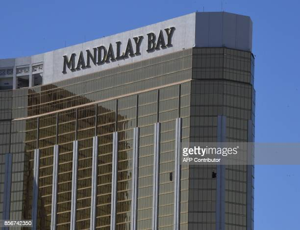 TOPSHOT The damaged windows on the 32nd floor room that was used by the shooter in the Mandalay Hotel after a gunman killed at least 58 people and...
