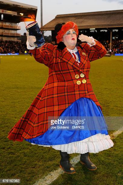 The Dame from the local pantomime production of Jack and The Beanstalk entertains the crowd at half time