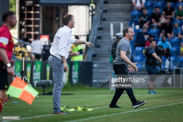 Kasper Hjulmand head coach of FC Nordsjalland and Alexander Zorniger head coach of Brondby IF at the sideline BRONDBY DENMARK MAY 28 the Danish Alka...