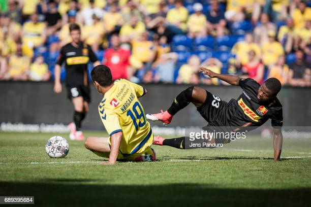 Christian Norgaard of Brondby IF and Collins Tanor of FC Nordsjalland in a duel BRONDBY DENMARK MAY 28 the Danish Alka Superliga match between...