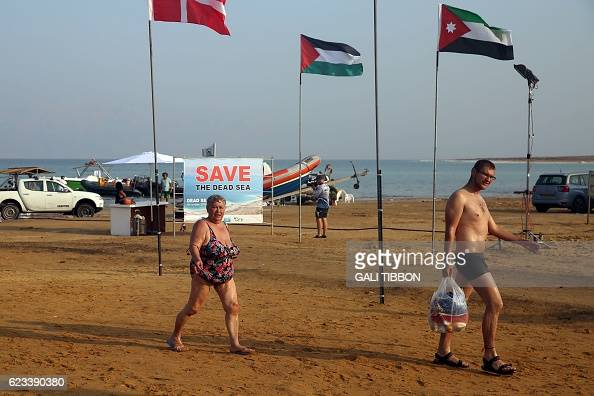 The Danish Palestinian and Jordanian flags are seen in the Israeli Dead Sea resort of Ein Gedi at the end of a 17kilometre swim from Jordan to Israel...
