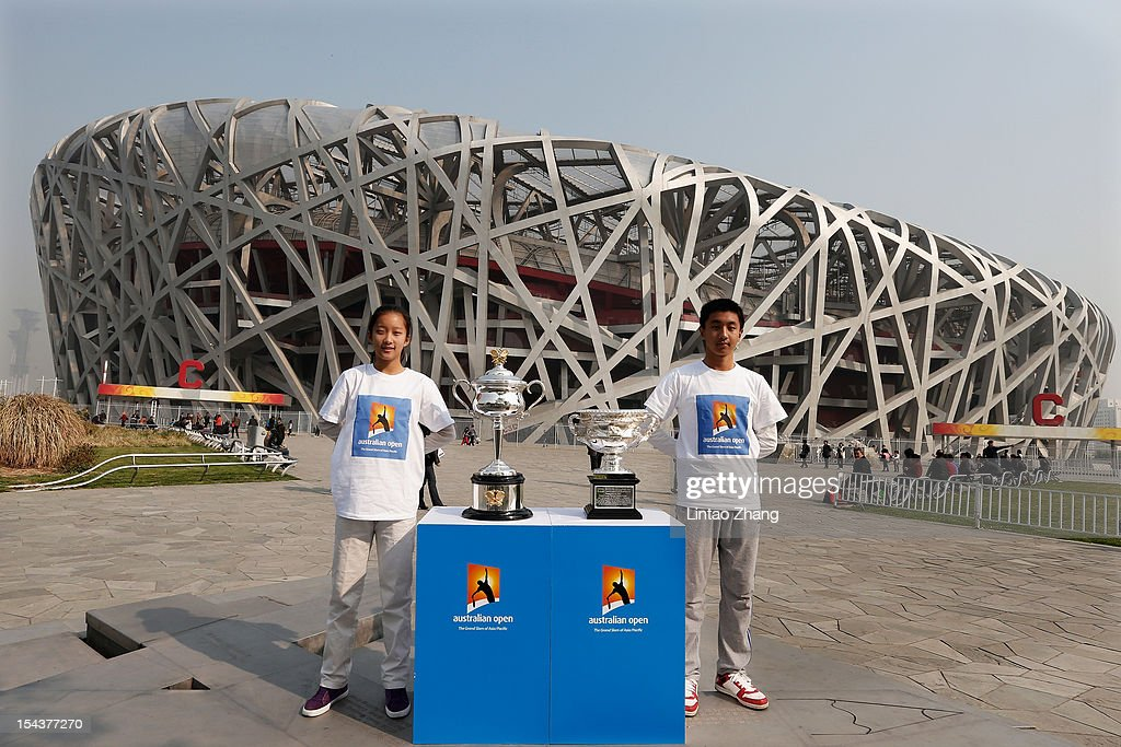 The Daphne Akhurst Memorial Cup (L) (women's trophy) and the Norman Brookes Challenge Cup (men's trophy) are pictured with caddy during the The Australian Open Trophies Tour at outside the Bird's Nest on October 19, 2012 in Beijing, China.