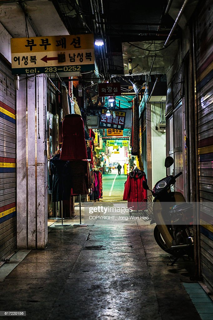 The dark pathway in the market building : Stock Photo