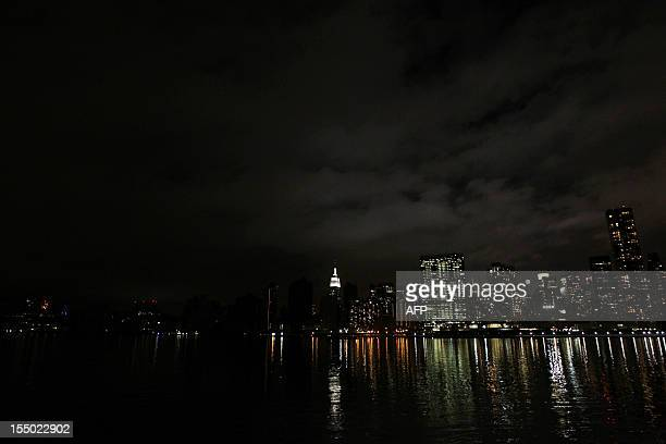 The darkened skyline of Manhattan is seen one day after Hurricane Sandy on October 30 2012 Life ground to a virtual halt in parts of southern...