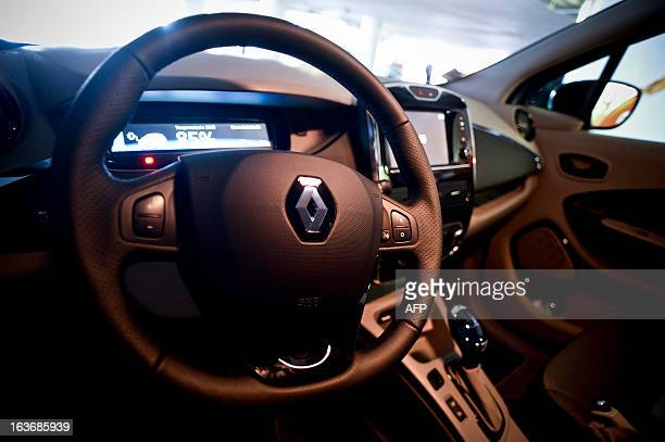 The dashboard and the steering wheel of a Renault's new electric car ZOE are pictured in a parking in downtown Lisbon on March 14 2013 AFP PHOTO/...