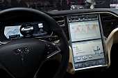 The dashboard of a Tesla Motors Inc Model S P85 vehicle is displayed at the 2015 North American International Auto Show in Detroit Michigan US on...