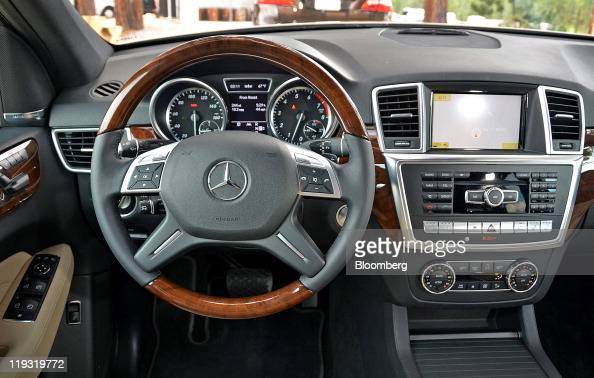 The dashboard of the 2012 Daimler AG MercedesBenz ML350 sport utility vehicle powered by a 35liter V6 gasoline engine is displayed during the...