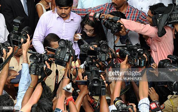 The daughter of former media executive Indrani Mukherjea Vidhie Mukerjea and her second husband Sanjeev Khanna are surrounded by media as they leave...
