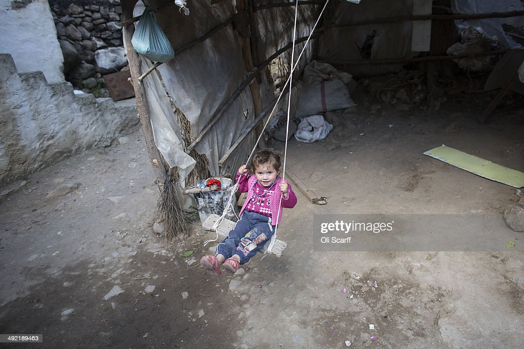 The daughter of miner Bilal Ay who died in the explosion at Soma mine plays on a swing at their home in the hamlet of Elmadere close to the mine...