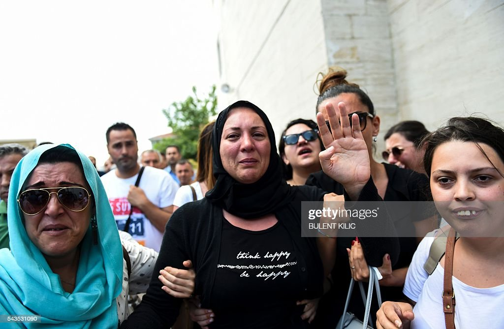 The daughter (C) of Siddik Turgan, a man who was killed in the June 28, 2016 airport attack, reacts as her father's coffin is carried nearby during his funeral ceremony on June 29, 2016 in Istanbul, a day after a suicide bombing and gun attack targeted Istanbul's airport, killing at least 41 people. Turkey declared on June 29, 2016 a day of national mourning over a deadly attack at Istanbul's international airport blamed by the government on Islamic State jihadists. / AFP / BULENT