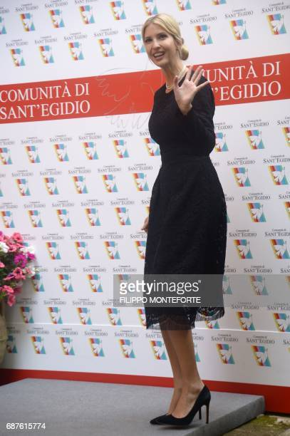 The daughter of US President Donald Trump Ivanka Trump waves at the end of her visit to the Vaticanaffiliated NGO the Community of Sant'Egidio where...