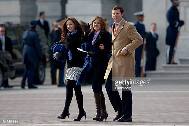 The daughters of Former President George W Bush Barbara and Jenna walk alongside Henry Hager husband to Jenna outside the US Capitol after President...
