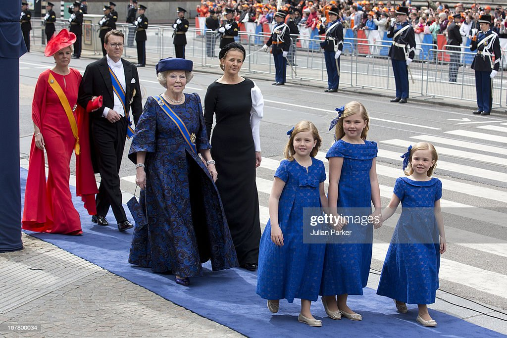 The Daughters of King Willem, and Queen Maxima, ( L TO R ) Princess Alexia, Princess Catharina Amalia, and Princess Ariane, followed by Princess Beatrix, and Princess Mabel, and Prince Constantijn, and Princess Laurentien arrive at the Nieuwe Kerk in Amsterdam for the inauguration ceremony of King Willem Alexander of the Netherlands, on April 30, 2013 in Amsterdam, Netherlands.