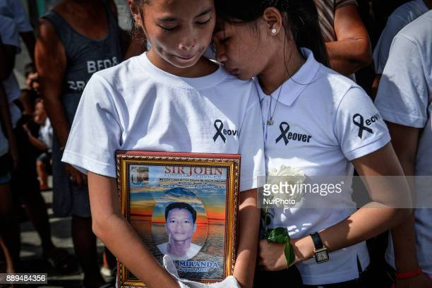 The daughters of Leover Miranda who was killed by police in an antiillegal drugs operation weep during his Manila Philippines August 20 2017 On...