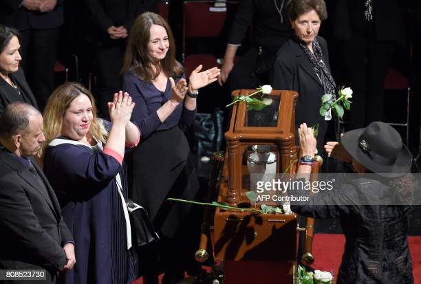 The daughters of Mexican painter and sculptor Jose Luis Cuevas Maria Jose Mariana and Ximena take part in a ceremony in his honor at the Fine Arts...