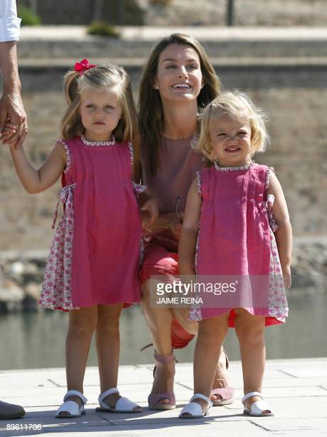 The daughters of Spanish Crown Prince Felipe Leonor and Sofia pose with their mother Princess Letizia during a walk in Palma de Mallorca on August 5...