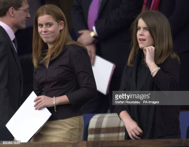 The daughters of the Duke and Duchess of York Princesses Beatrice and Eugenie arrive to take their seats in the Royal Box in the gardens of...