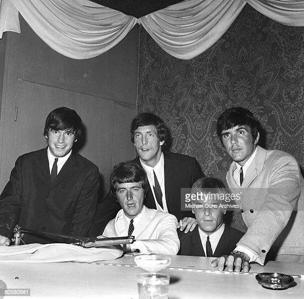 The Dave Clark Five LR Denis Peyton Rick Huxley Mike Smith Lenny Davidson and Dave Clark jam at a piano circa 1965 in Los Angeles California