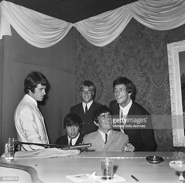 The Dave Clark Five LR Rick Huxley Denis Peyton Lenny Davidson Dave Clark and Mike Smith jam at a piano circa 1965 in Los Angeles California