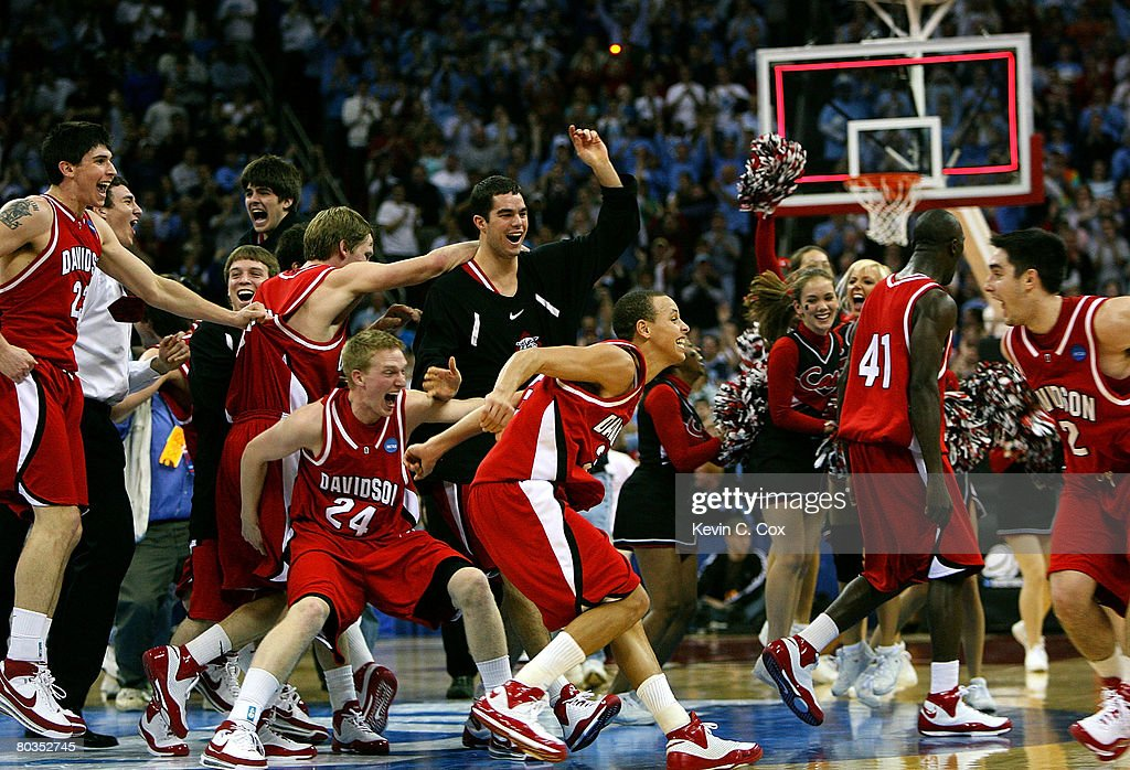 The Davidson Wildcats celebrate after defeating the Georgetown Hoyas 74-40 during the 2nd round of the 2008 NCAA Men's Basketball Tournament at RBC Center March 23, 2008 in Raleigh, North Carolina.