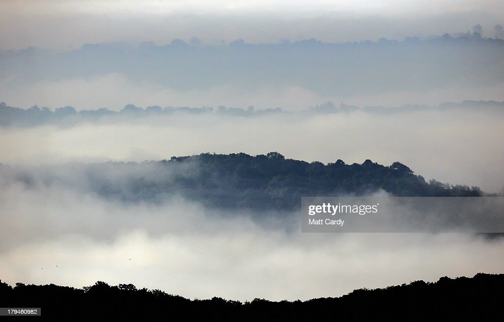The dawn sun begins to clear the mist and fog lingering in fields close to the city of Wells on September 4, 2013 in Somerset, England. Parts of the UK are set to enjoy a late summer heatwave today, with temperatures possibly reaching 28C in central, eastern and southern England, with temperatures predicted to climb even higher tomorrow.