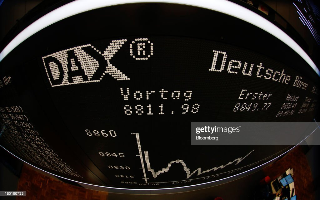 The DAX index curve is displayed on an electronic board in this photograph taken with a fish-eye lens at the Frankfurt Stock Exchange in Frankfurt, Germany, on Friday, Oct. 18, 2013. Global stocks rose for a third day, extending a five-year high, and copper climbed after China's economic growth quickened. Photographer: Ralph Orlowski/Bloomberg via Getty Images