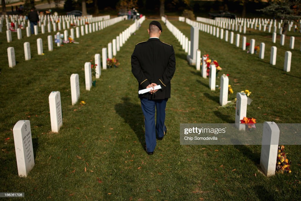The day after Veterans Day, U.S. Army Staff Sgt. Luke Parrott walks through the rows of headstones in Section 60 where several of his friends and soldiers he served with are buried at Arlington National Cemetery November 12, 2012 in Arlington, Virginia. A veteran of the wars in Afghanistan and Iraq, Parrott was injured in an IED blast in Baghdad in 2005. Parrott spent time sitting and talking to the graves of the soldiers he knew. 'It's as close as we can get to talking anymore,' he said.