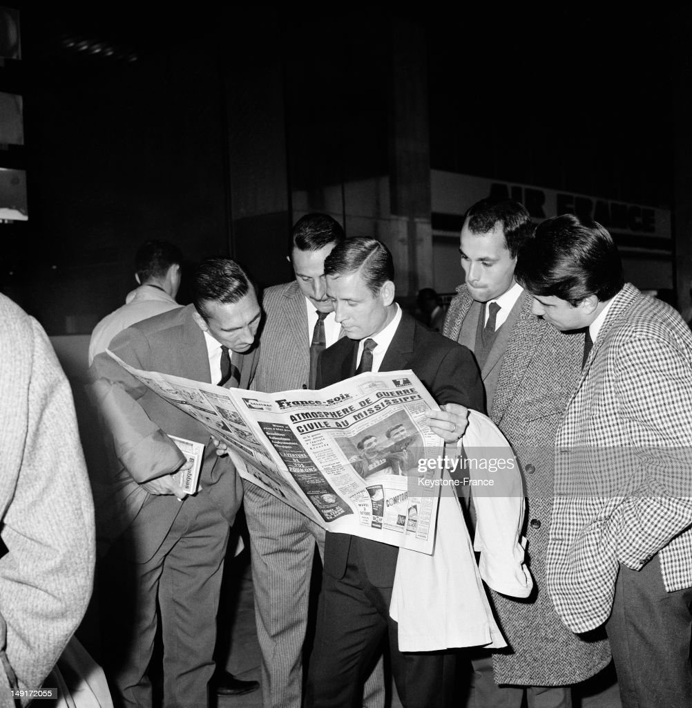 The day before the Game against British National Team in Sheffield french soccer player Raymond Kopa and team mates read the newspaper at Paris Orly Airport just before boarding on October 1, 1962 in Paris, France.