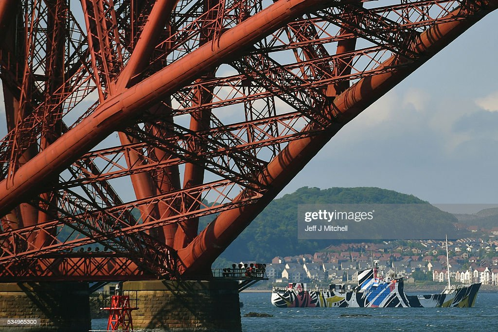 The dazzle ship passes under the Forth Rail Bridge as people gather to commemorate the Battle of Jutland on May 28, 2016 in South Queensferry, Scotland. The events begin a weekend of commemoration leading up to the anniversary on 31 May and 1 June to mark the centenary of the largest naval battle of World War One where more than 6,000 Britons and 2,500 Germans died in the Battle of Jutland.