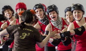 The DC Rollergirls congratulate one of the coaches from the Rideau Valley Vixens from Ottawa Ontario Canada at the end of a Roller Derby match April...