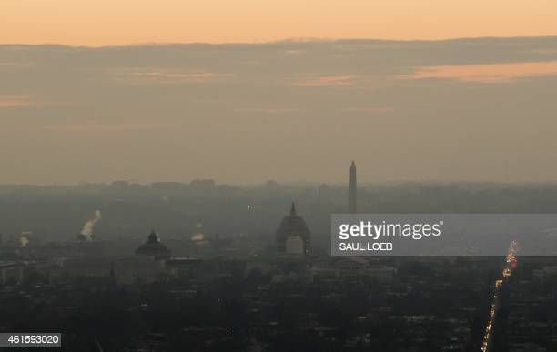 The DC skyline including the US Capitol and Washington Monument are seen at sunset in this aerial photograph over Washington DC January 15 2015 AFP...