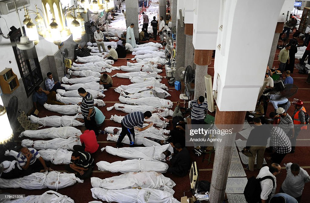 The dead bodies of supporters of Mohammed Morsi and the Muslim Brotherhood lie in the Iman Mosque located at Rab'a al-Adaweya Square on August 15, 2013 in Cairo, Egypt. The death toll of supporters of Mohammed Morsi and the Muslim Brotherhood is believed to be approximately 310 people.Mohammed Morsi, Egypts first democratically elected president, was ousted by Egyptian army in a military coup on July 3, 2013.