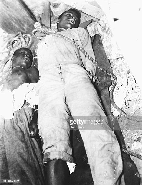 The dead bodies of two fourteenyearold lynching victims Charles Lang and Ernest Green lie on the ground with ropes still tied around their necks