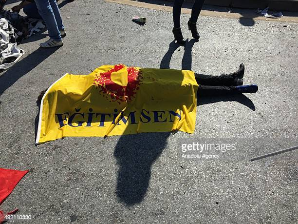 The dead body of a victim lays on the ground at the site of an explosion close to Ankara's main train station on October 10 2015 in Ankara Turkey An...