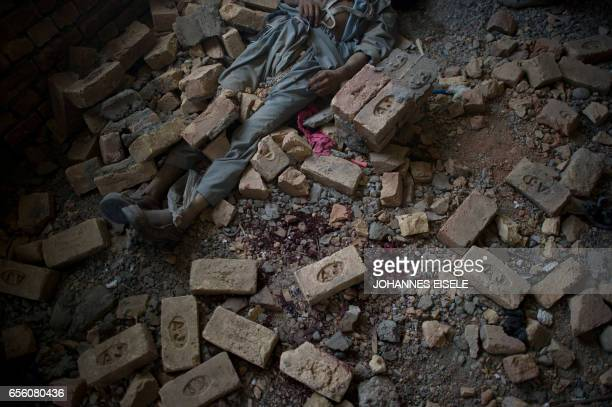 The dead body of an insurgent lies on the floor inside a building in Kabul on April 16 2012 A total of 36 Taliban militants were killed as they...