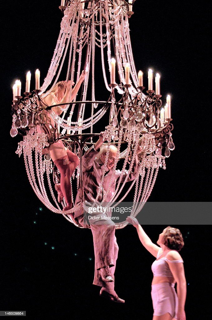 The Dead Clown and a woman perform aerial acrobatics on a giant chandelier during the Belgian premiere of the Cirque du Soleil show Corteo on June 13, 2012 in Antwerpen, Belgium.
