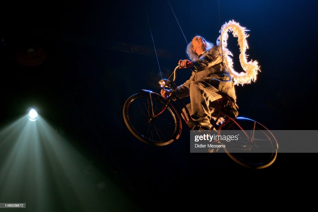 The dead clown riding on this bicycle in the top of the tent during the Belgian premiere of the Cirque du Soleil show Corteo on June 13, 2012 in Antwerpen, Belgium.