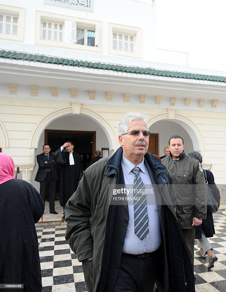 The dean of the faculty of arts, letters and humanities at Manouba University, Habib Kazdaghli (C), accused of slapping a female student wearing an Islamic veil, arrives at the Manouba court near Tunis, on January 3, 2013. Kazdaghli, whose trial has gripped Tunisia for months amid bristling tensions between secularists and hardline Salafists, attended a new hearing in the case. AFP PHOTO / FETHI BELAID
