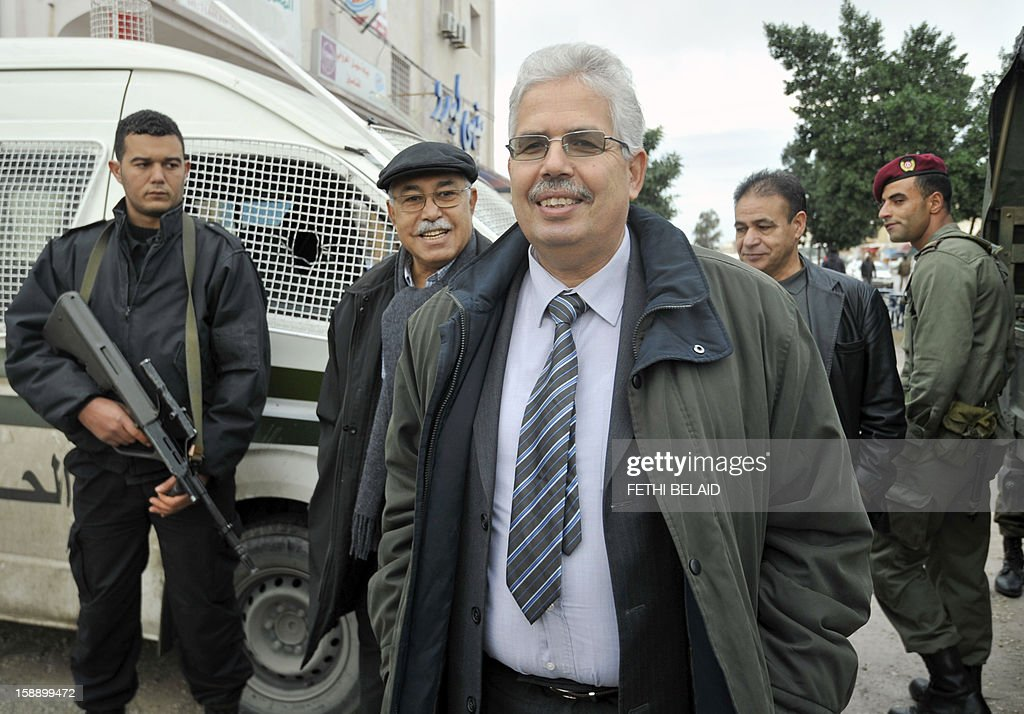 The dean of the faculty of arts, letters and humanities at Manouba University, Habib Kazdaghli (C), accused of slapping a female student wearing an Islamic veil, arrives at the Manouba court near Tunis, on January 3, 2013. Kazdaghli, whose trial has gripped Tunisia for months amid bristling tensions between secularists and hardline Salafists, attended a new hearing in the case.