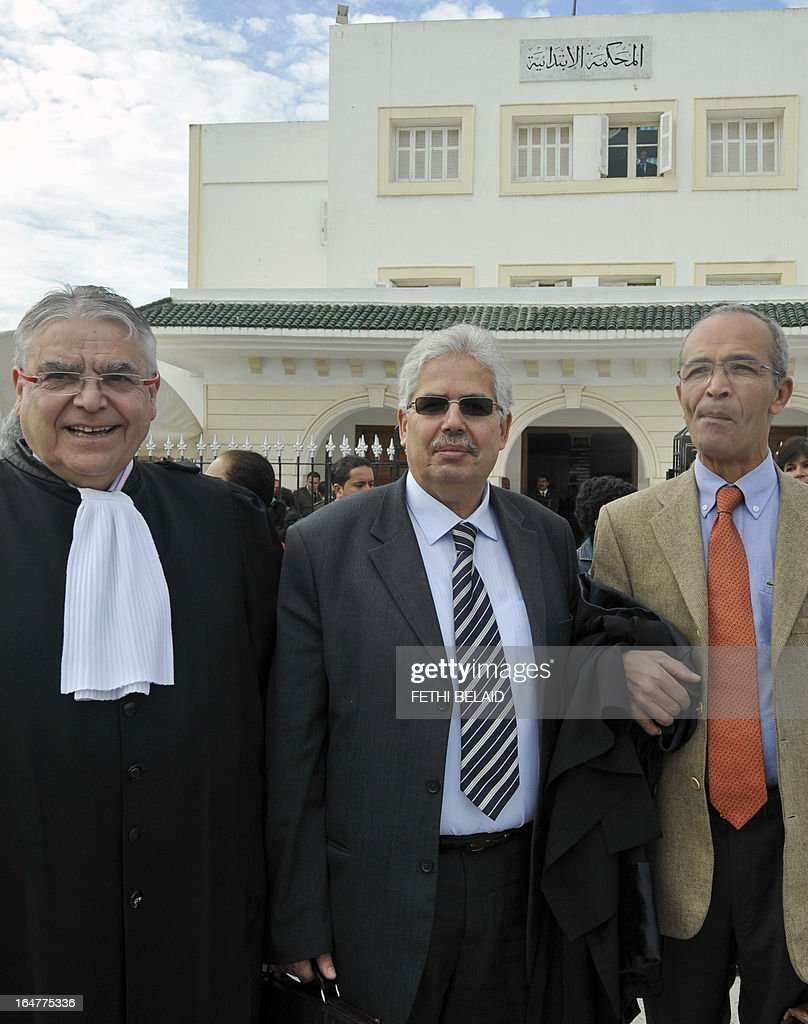 The dean of the faculty of arts, letters and humanities at Manouba University, Habib Kazdaghli (C), accused of slapping a female student wearing an Islamic veil, arrives at the Manouba court, near Tunis, with his lawyers Larent Philippe (L) and Habib Khemiri (R) on March 28, 2013. The verdict of Kazdaghli's trial, that has gripped Tunisia for months amid bristling tensions between secularists and hardline Salafists, was delayed as hundreds of people protested outside the court.
