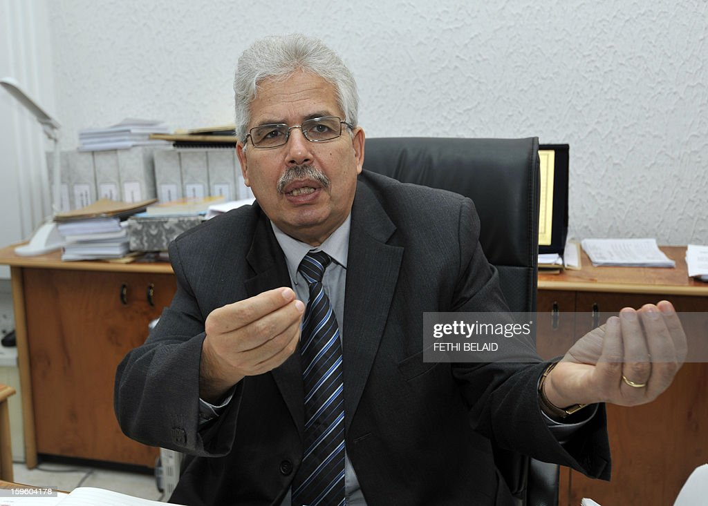 The dean of the Manouba Faculty of Arts, Letters, and Humanities, Habib Kazdaghli answers journalists' questions in his office on January 17, 2013, outside Tunis. Kazdaghli's trial, in which he is accused of slapping a female student wearing an Islamic veil, has been postponed by the court to March 28, 2013. AFP PHOTO / FETHI BELAID